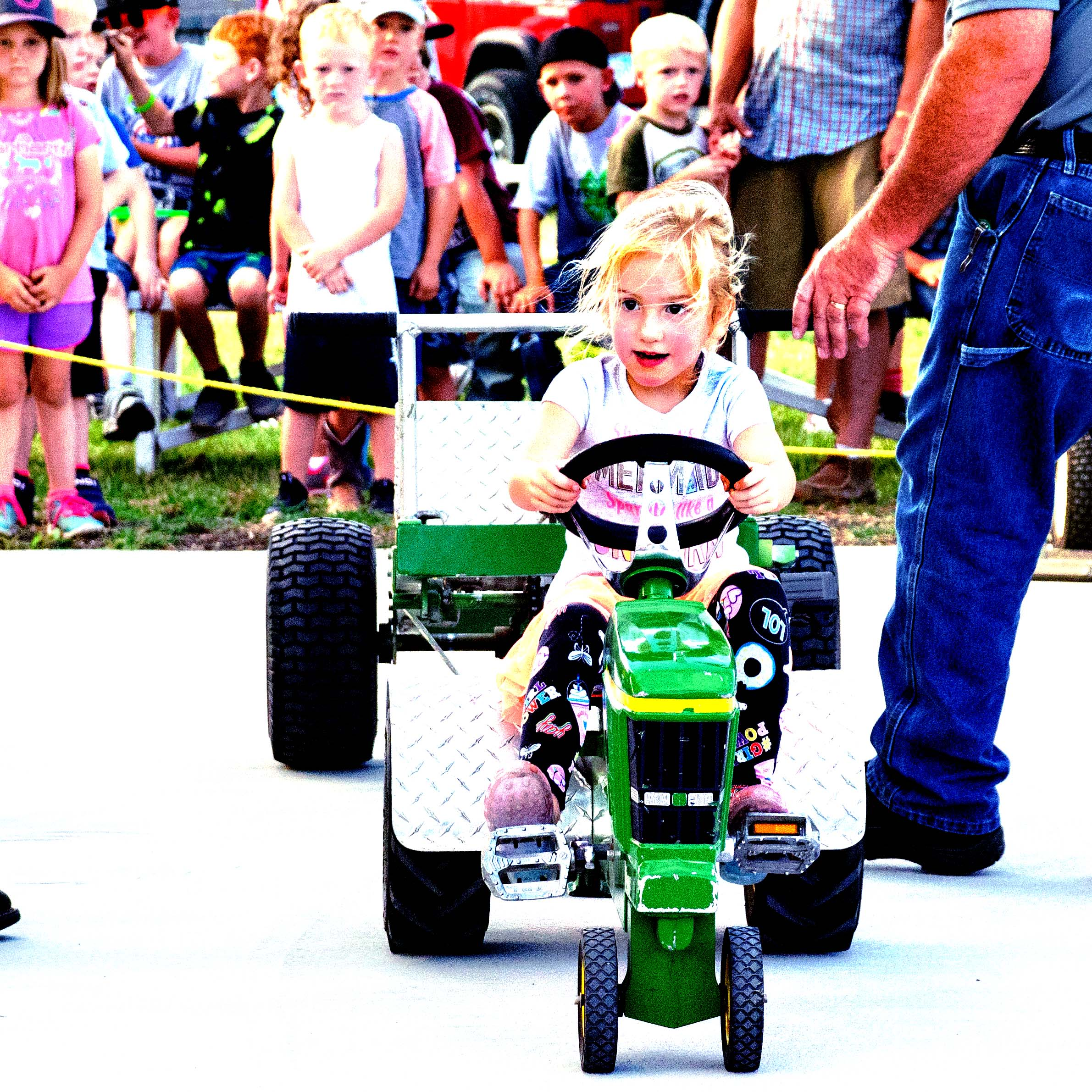 Ryan Barkdull of Diamond Archery in Wichita displays rattlesnake meat prepared in a smoker. He was assisted by Dan Hague of Aulne.