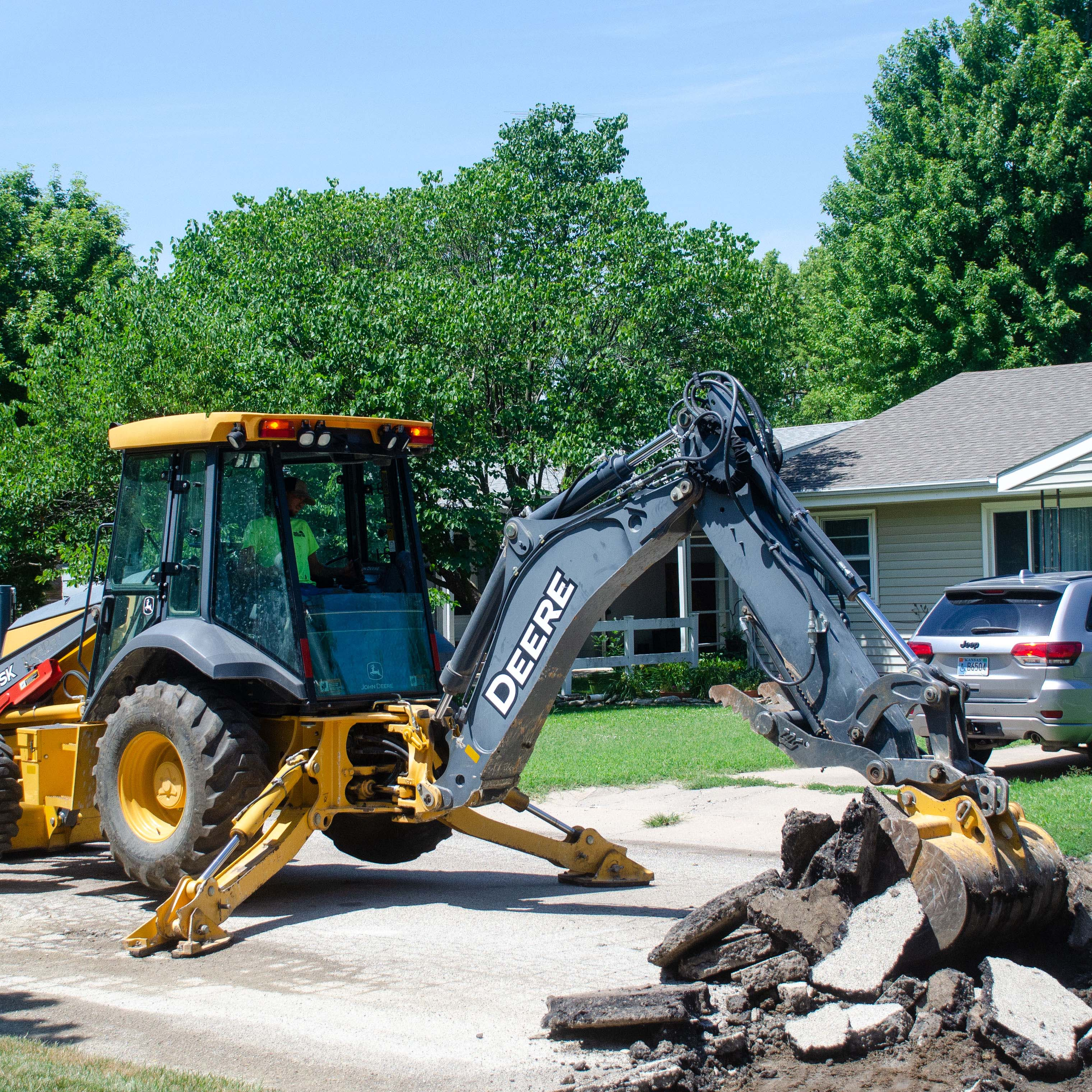 Emmanuel Baptist Church pastor Josh Wesner plays guitar and sings with children during a recent mission trip to Haiti with six other members.