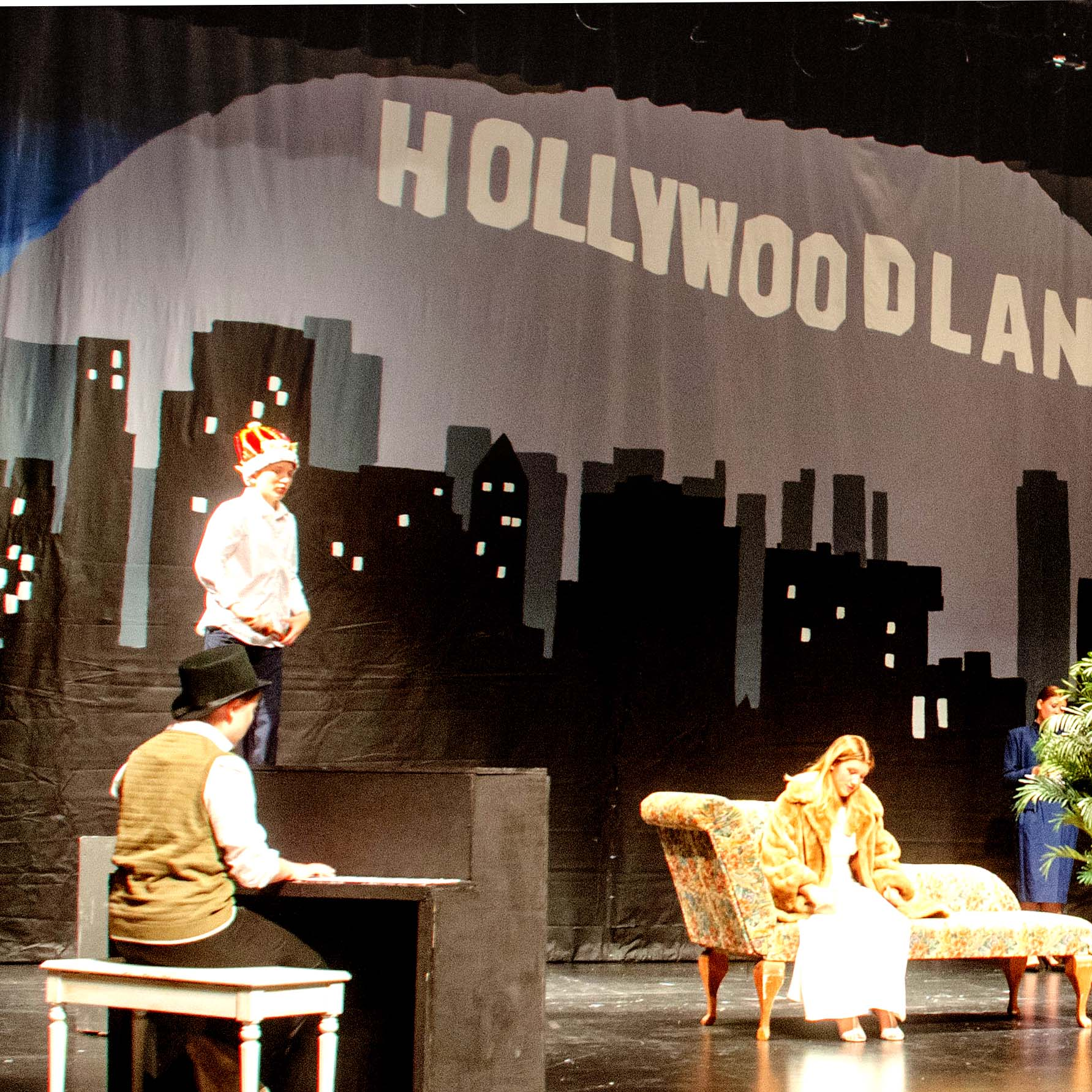 Flint Hills Market and Bakery employee Sandy Harper tallies the grocery bill for Florence Mayor Bob Gayle on Saturday. The new store in the renovated opera house downtown drew a big crowd on its opening day, and owner Jenny Lee said all of the baked goods sold out.