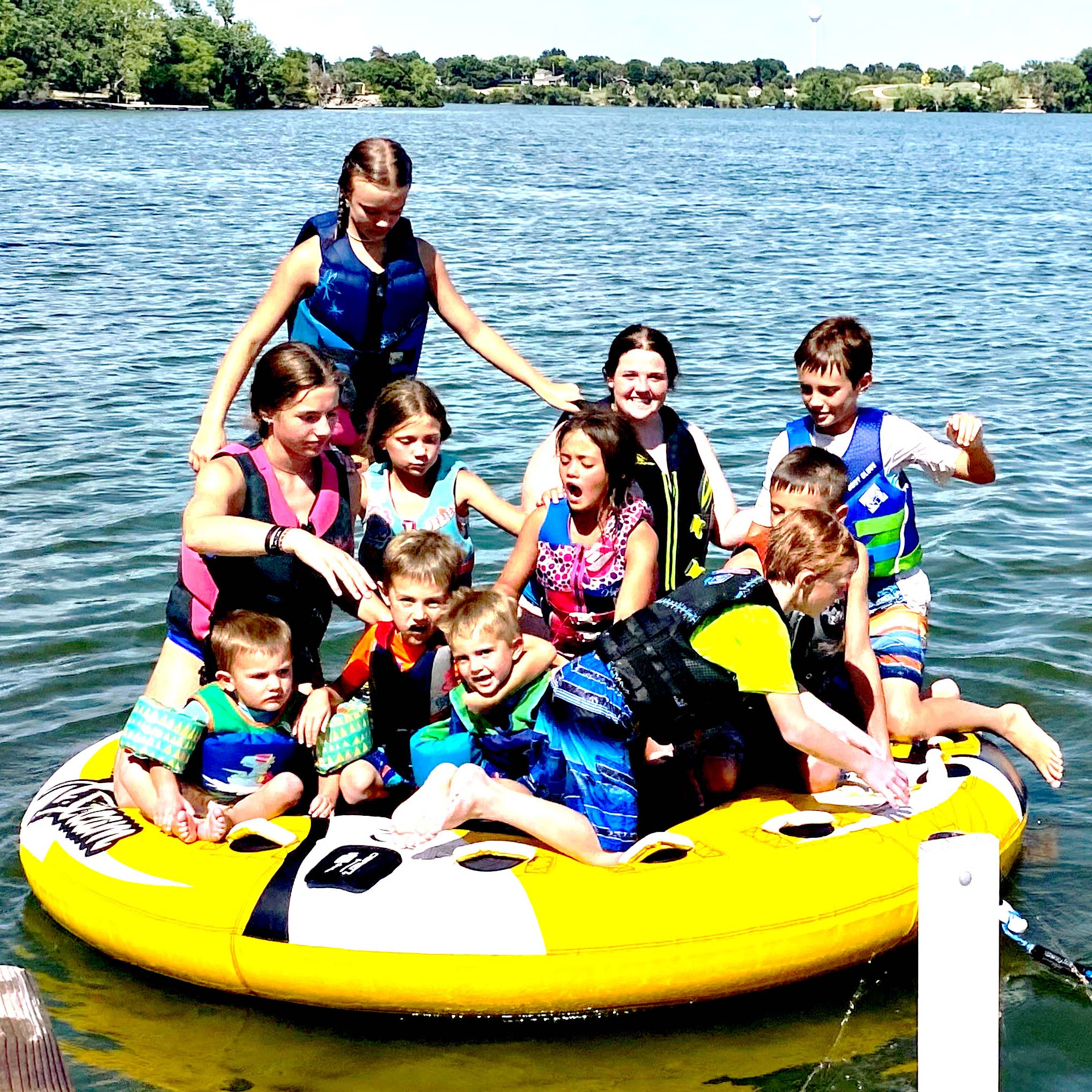 As Dylan Becker inspects his putter, Christian Becker lines up a putt during Marion High School golf practice last week at Marion Country Club. Coach Scott Bauer hopes to add another couple of players to the nine Marion and Peabody-Burns golfers already practicing for their first tournament in April.